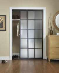 bedroom small walk in closet design with sliding door and white