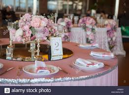wedding preparation table appointments in restaurant pink wedding preparation stock