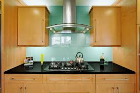 blue glass tile backsplash kitchen traditional with alaska white