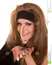 halloween witch with claw finger and spider stock photography