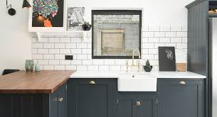 this tone wood butcher block island top with navy cabinets