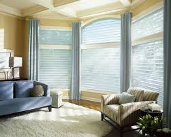 corner glass window with white blind also gray curtains placed on