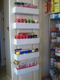 tiered white wall mount pantry cabinet in sliding kitchen door