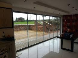 Folding Glass Patio Doors Prices Ideas Folding Glass Patio Doors Or Glass Garage Doors For Patios