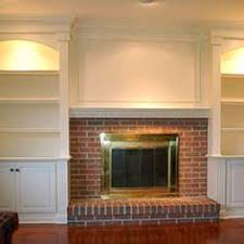 built in bookshelves around fireplace great use of space family