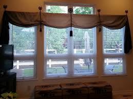 diy western style window treatment with horseshoes and tassels