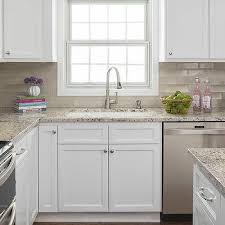 white kitchen cabinets with taupe backsplash light taupe ceramic kitchen backsplash tiles design ideas