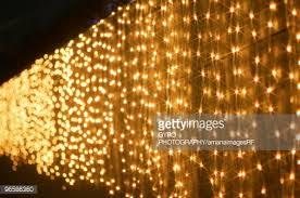 Amber Christmas Lights Christmas Lights Hanging Over A Wall Stock Photo Getty Images