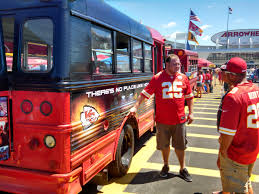 party bus outside these kansas city chiefs fans turn old buses into red and