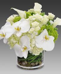 white floral arrangements celestial white hydrangea roses orchids unique and