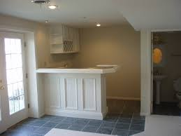 finished basement company basement wet bar under stairs and