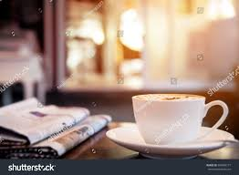 cup cappuccino newspaper on table coffee stock photo 304865177