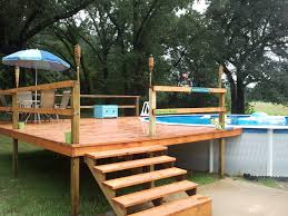 decor wood decks and outdoor pool with patio umbrella for