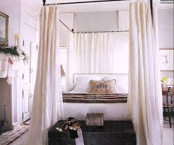 wide fireplace and diy canopy bed for traditional bedroom with