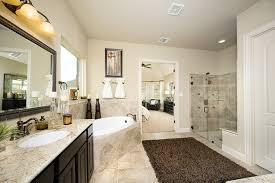 gehan homes master bathroom tan granite countertops dark wood