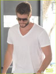 liam hemsworth miley cyrus plans on growing hair long photo