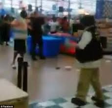 thirty person brawl at walmart captured on video with swinging