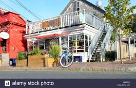 street scene of provincetown cape cod with tour trolley bus stock