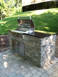 outdoor poolside small outdoor stone kitchen with modern grill
