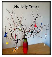 sun hats wellie boots decorating a nativity tree