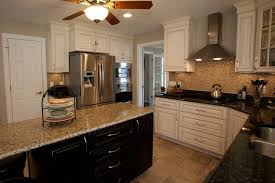 kitchen island with white granite countertop and sink also black