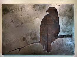 eagle on a branch wall metal reclaimed wood and aged