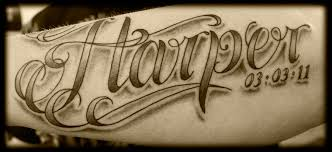 cursive lettering tattoo on ribs photos pictures and sketches