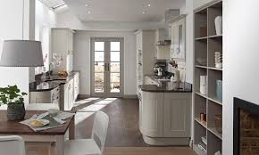 natural stone kitchen backsplash with tea kettle paper towel