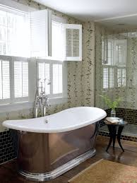bathroom clear glass window with freestanding bathtun also wooden