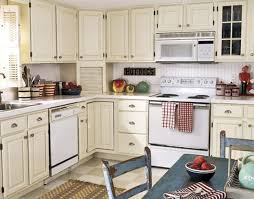 country kitchen with white cabinets appliances unique counters details in tile backsplash also