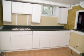 white melamine kitchen cabinets how to update 80 s melamine cabinets white kitchen cabinet