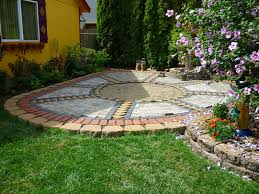 wow thats a busy garden creating a paver and pebble mosaic patio