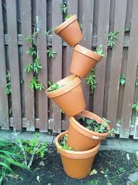 Clay Pot Garden Art - 45 cool tipsy pot planters u2014 style estate