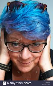 middle aged woman with dyed blue hair stock photo royalty free