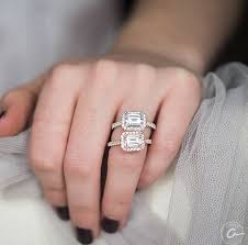 engagement rings emerald cut east west emerald cut pave halo engagement ring engagement rings
