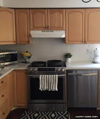 how to paint wood cabinets white painting kitchen cabinets before after