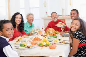 happy family enjoying thanksgiving dinner stock photo colourbox