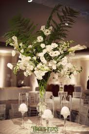 White Rose Centerpieces For Weddings by Tall White Floral Centerpieces With Large Fern Leaves For More