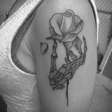 skeleton hand holding a rose tattoo first tattoo aesthetic