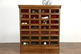 sold oak antique file cabinet 28 glass front display drawers