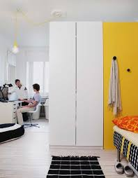 Room Dividers For Kids - a tall wardrobe as room divider for two teen boys apartment therapy