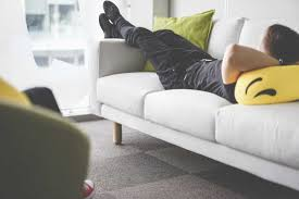 young man napping on white sofa in the office free stock photo