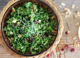kale and brussels sprout salad with cranberries toasted almonds