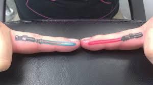 lightsaber finger tattoos lightsaber finger and tattoo