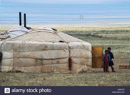 children in front of a house yurt traditional nomadic dwelling