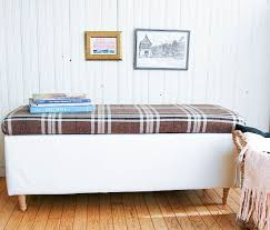 how to turn a boring storage ottoman into a one of a kind piece