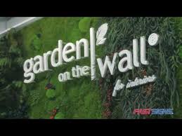 fastsigns helps garden on the wall grow their brand with signage