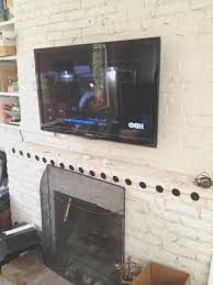Mounting A Tv Over A Gas Fireplace by Fireplace Hang Tv Above Brick Fireplace Can You Hang A Tv Above