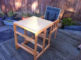 wooden high chair that converts into a chair table