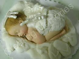 baby angel edible cake toppers made of vanilla fondant and
